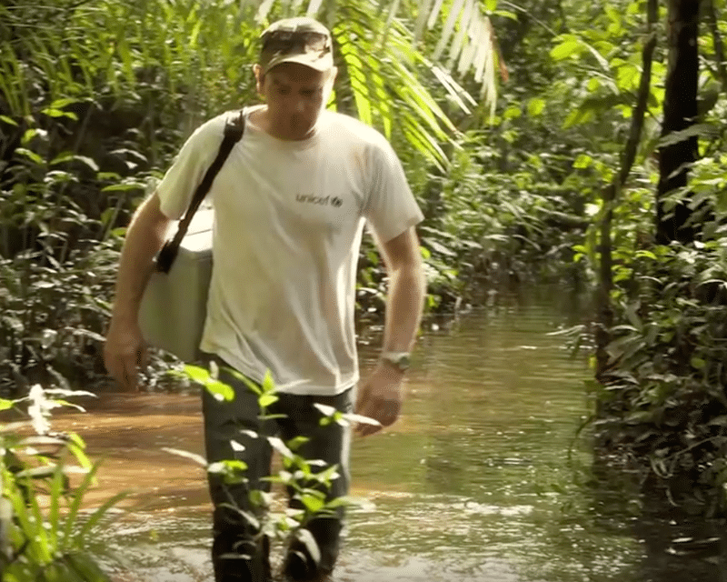 Ewan McGregor walking through rainforest and rivers to deliver medicines to remote communities