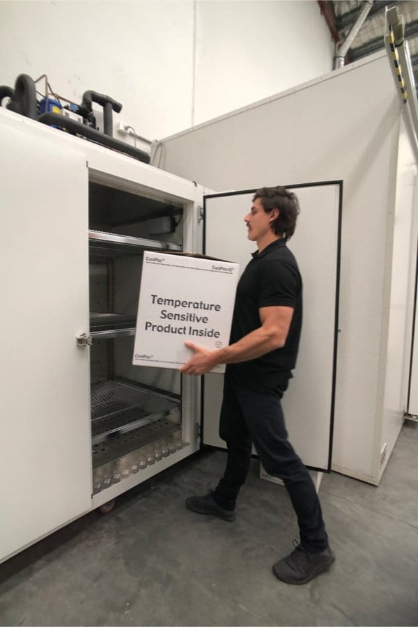 Packed cold chain shipper being placed into a environmental chamber for testing